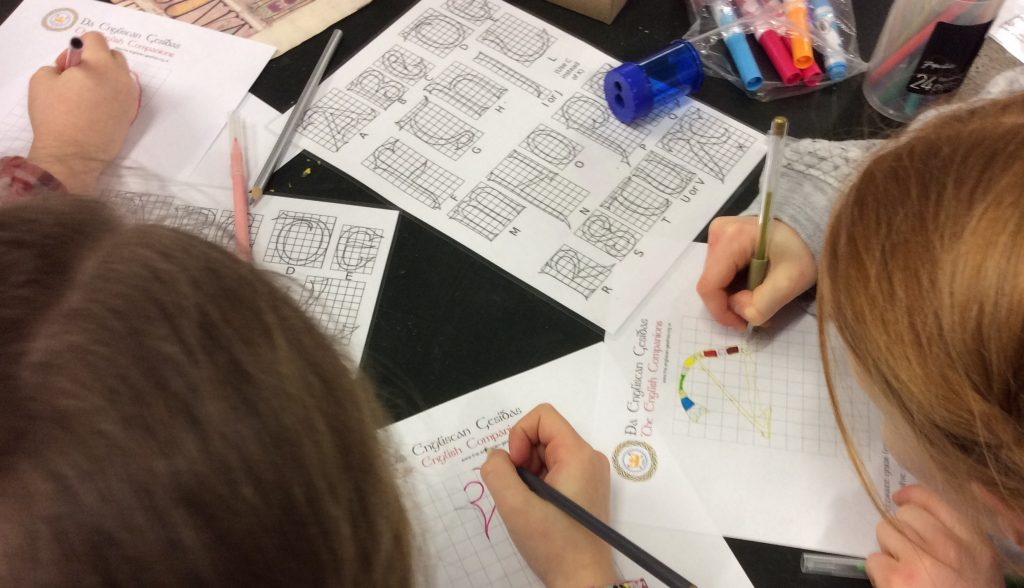 Children writing in Old English