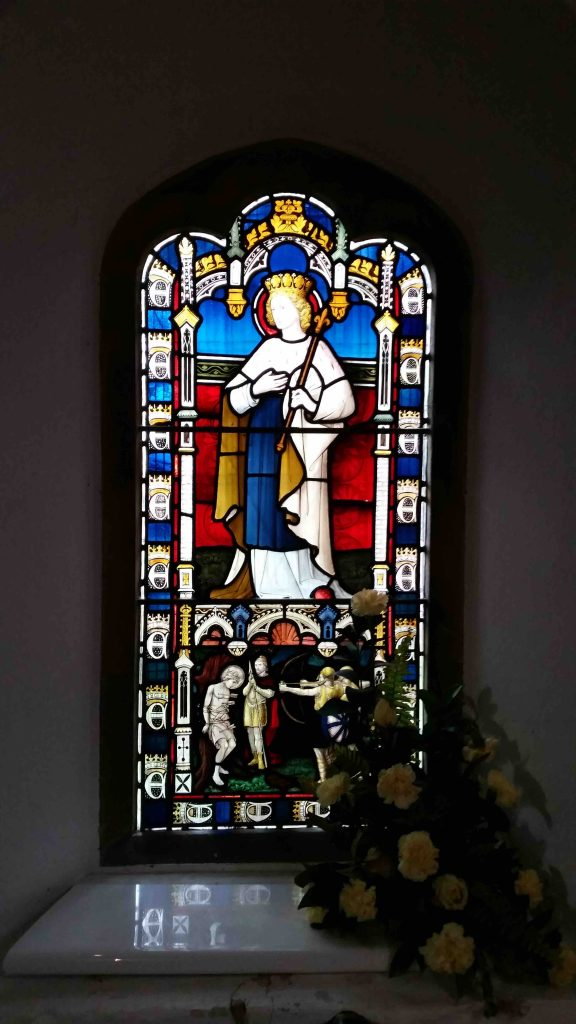 Stained glass window of St. Edmund in Greensted Church